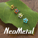 neometal threadless jewelry ends displayed on a leaf