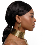a woman in profile wearin gold tone jewelry